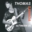 THOMAS SAWADA BETWEEN US
