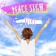 YOKO PEACE SIGN